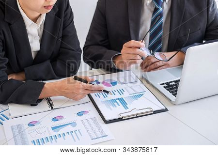 Business team partner meeting working and negotiation analyzing with financial data and marketing growth report graph presentation in team, Meeting Talking Brainstorming Communication Concept. stock photo