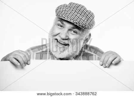 cheerful grandpa. job search. Need help. wanted. Copy space placate information. happy mature man in retro hat. Advertisement. Advertisement shop. Senior bearded man place announcement on banner stock photo