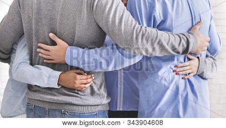 Together we are strong. Group of people embracing in circle and bonding to each other, close up stock photo