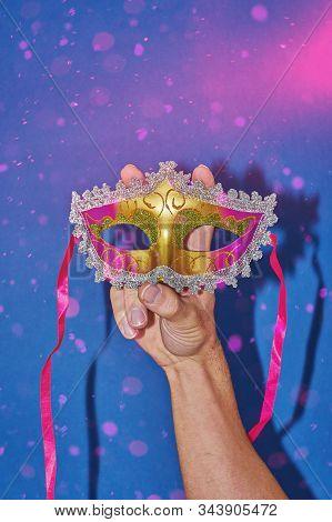 Mardi Gras carnival masquerade mask on blue background with confetti, copy space. New Orleans carnival Mardi Gras day party bright festive decor. Invitation, banner, card, poster, flyer stock photo