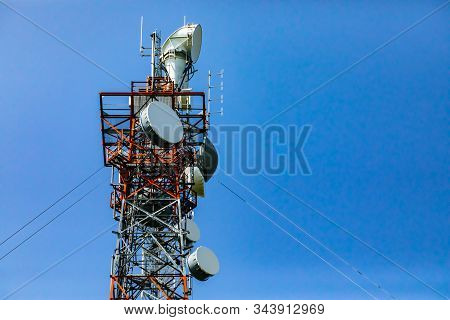 A low angle detailed view of a cable stayed steel lattice pylon housing electronic communication equipment for 3G, 4G, 5G signal strength and coverage stock photo