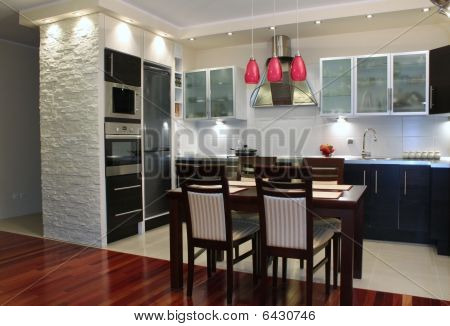 Beautiful luxury modern kitchen with exotic wood on the floor stock photo