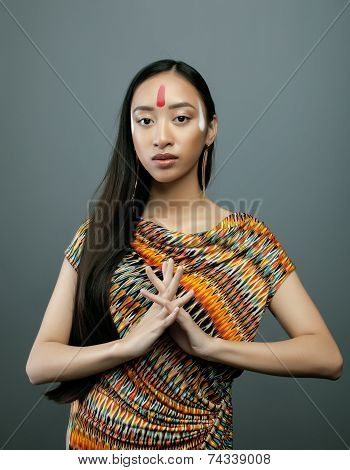 beauty young asian girl with make up like Pocahontas, red indians woman long hair stock photo