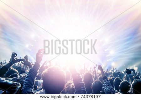 Outdoor concert, happy people with raised up hand enjoying night in the club, night entertainment, a
