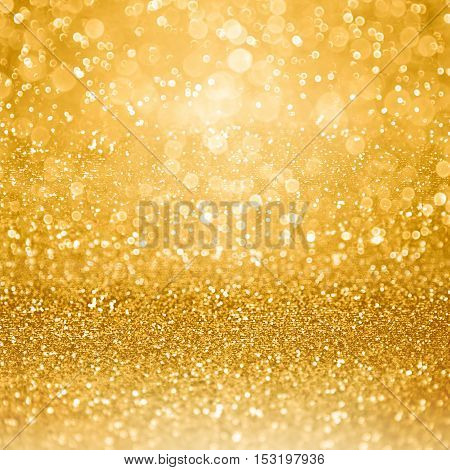 Abstract glamorous gold glitter sparkle confetti background or glitzy glam luxury golden color party invitation for birthday anniversary wedding Christmas or new year's eve