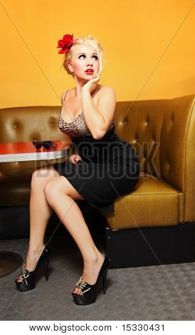 Pinup girl at a cafe stock photo