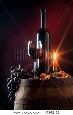 Still life with red wine and candle stock photo