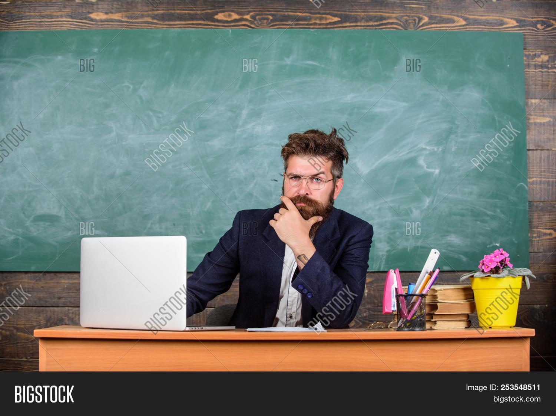 academic,am,back,background,beard,bearded,blackboard,caucasian,chalkboard,classroom,college,computer,concept,desk,education,eyeglasses,formal,handsome,headteacher,hipster,i,intelligent,knowledge,laptop,learn,lesson,man,mature,mustache,new,notebook,professor,ready,school,september,serious,sit,smart,start,stationery,study,subject,system,teach,teacher,to,training,tutor,your