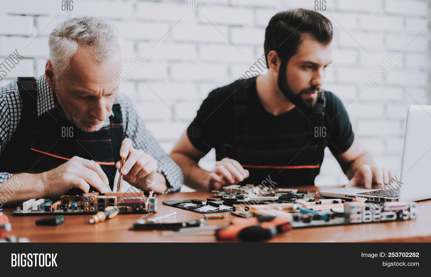 Two Men Repairing Hardware Equipment From Pc Repair Shop Worker And Diagnostic Of Electronic Circuit Board Stock Photo Appliance Assembly