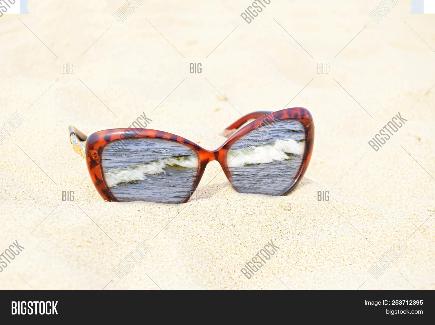▷ Sunglasses Are On Sand. The Image Of The Sea Is In A Frame Of ...