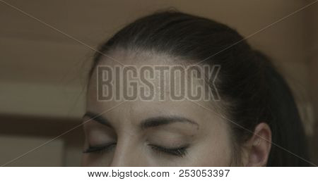 Relaxed woman relaxing in a wooden infrared sauna stock photo