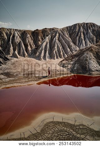 Woman with hat on background fantastic earth with red river at aerial view. Fantastic view. Martian landscape stock photo