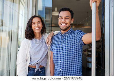 Mixed race couple outside the coffee shop they own stock photo