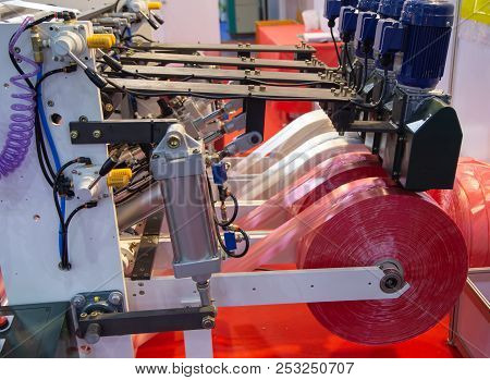 Extruder of polyethylene for industry process of plastic bag stock photo