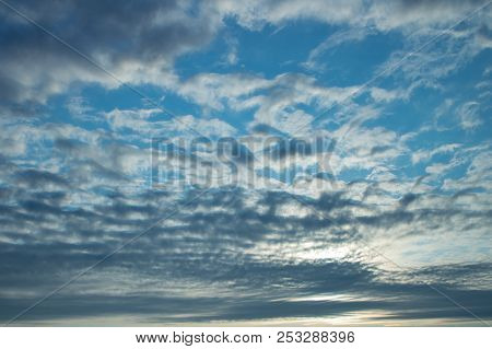 Cloudy Skies with Stratocumulus Hiding a Sunset stock photo