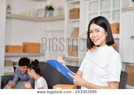 Sme business concept. Young Asian people are packing their packages.Delivery business  Small and Medium Enterprise (SMEs). Young man is working in the house.Young Owner Start up for Business Online. stock photo