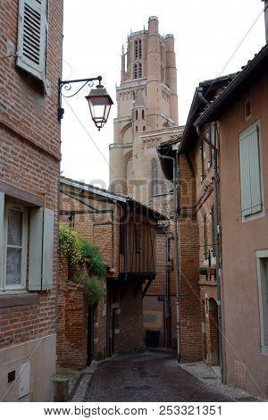 Albi street in a rainy day with the cathedral at the background. stock photo