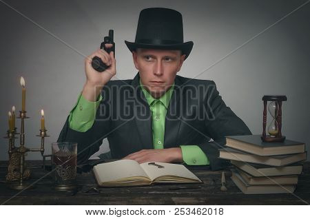 Confident detective spy agent holding in hands a gun. Detective or spy agent or police inspector concept. stock photo