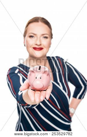 selective focus of businesswoman showing pink piggy bank isolated on white background stock photo