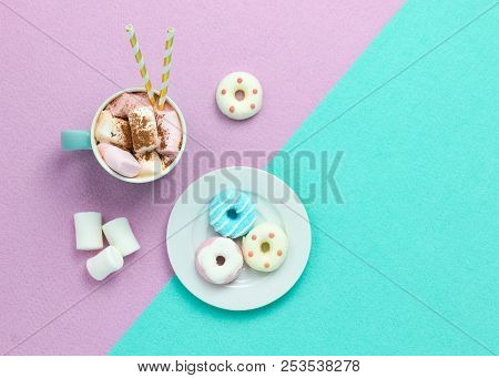 Top view of a cup of hot chocolate with marshmallows. Cup of hot cocoa with marshmallow an cocoa topping. Bright pastels theme with copy space stock photo