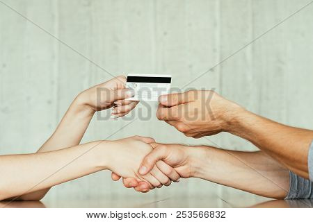 online money loan. financial operations on the internet. handshake after deal closure and electronic transfer using credit or debit bank card stock photo