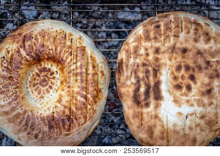 Bread on the grill with open fire stock photo