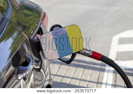 Flag of Canary Islands on the car's fuel tank filler flap. Fueling car with petrol pump at a gas station. Petrol station. Gasoline and oil products. Close up. stock photo