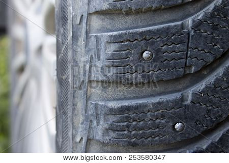 Protector on winter studded rubber close up stock photo