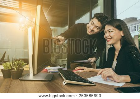 asian younger freelance man and woman working on computer at home office stock photo