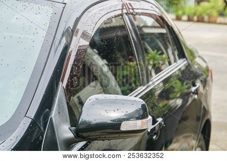close up wing mirror with LED light bar of black car stock photo