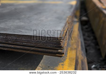 Steel sheets deposited in stacks in packs at the warehouse of metal products. Weathered metals sheet for construction. Metal corrosion. stock photo