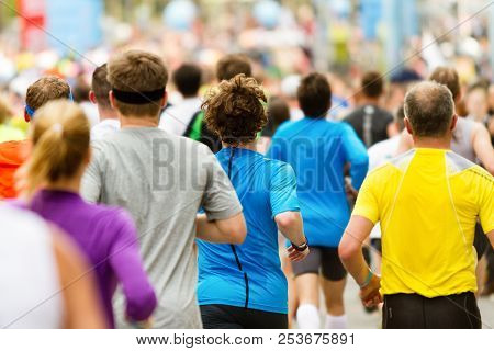 Running Crowd At The Marathon. Many Runners Passing The Start Or Finish Line.