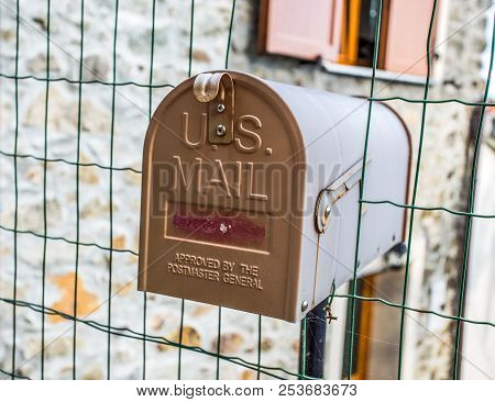 Front door of a mailbox mounted on the house gate stock photo
