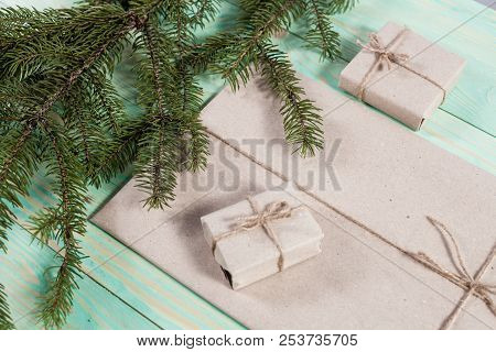 Gift boxes wrapped kraft paper tied with twine and paper snowflake and tied with twine. with copy space stock photo