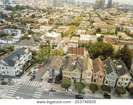 Aerial view famous Alamo Square in Western Addition neighborhood, San Francisco, California, USA. Famous hillside park Alamo Square attraction with typical Victorian houses and crowd of tourists stock photo