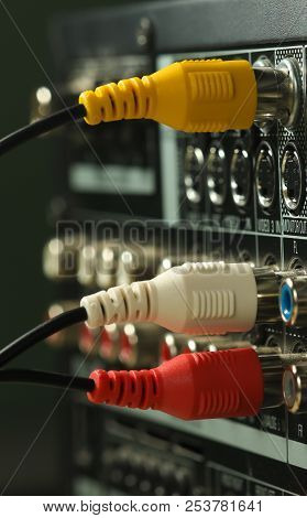 Yellow, white and red Audio cables and connectors on music amplifier back panel stock photo