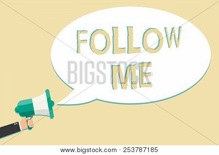 Writing note showing Follow Me. Business photo showcasing Inviting a person or group to obey your prefered leadership Man holding megaphone loudspeaker speech bubble message speaking loud. stock photo