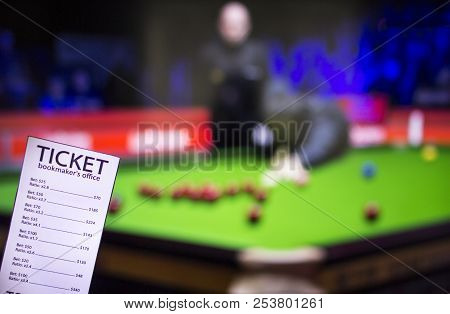Bookmaker Ticket On The Background Of The Tv, Which Shows A Game Of Snooker, Sports Betting, Bookmak