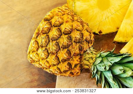 Pineapple on wood texture background. Whole and sliced tropical pineapple on wooden cutting board  with copy space. Top view stock photo