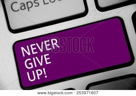 Word writing text Never Give Up. Business concept for Keep trying until you succeed follow your dreams goals Keyboard purple key Intention create computer computing reflection document. stock photo