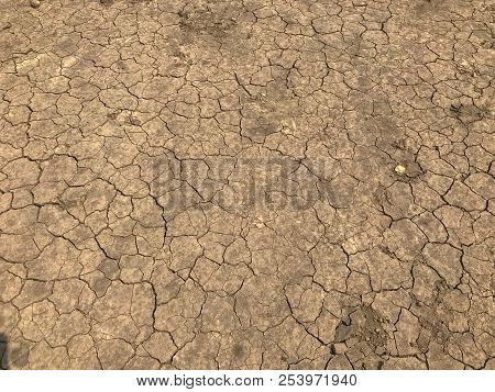 yellow crack dry dirt background texture and tire stock photo