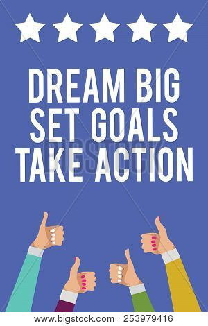 Text sign showing Dream Big Set Goals Take Action. Conceptual photo Motivation to follow your dreams Inspiration Men women hands thumbs up approval five stars information blue background. stock photo