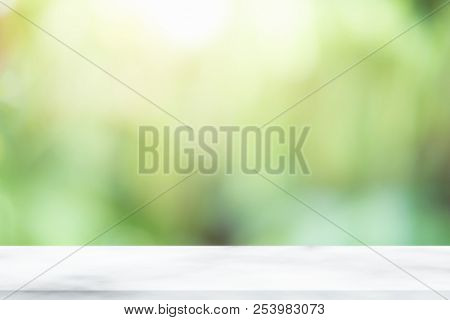 Empty wooden desk of free space and spring time with blurred background of home garden for a catering or food background,Template mock up for display montages of product. stock photo