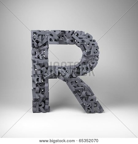 Letter R made out of scrambled small letters in studio setting stock photo