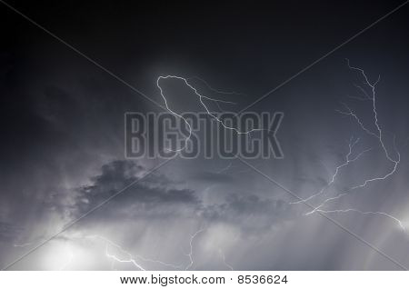 Spectacular display of lightning striking through a rain storm during a Florida summer night stock photo