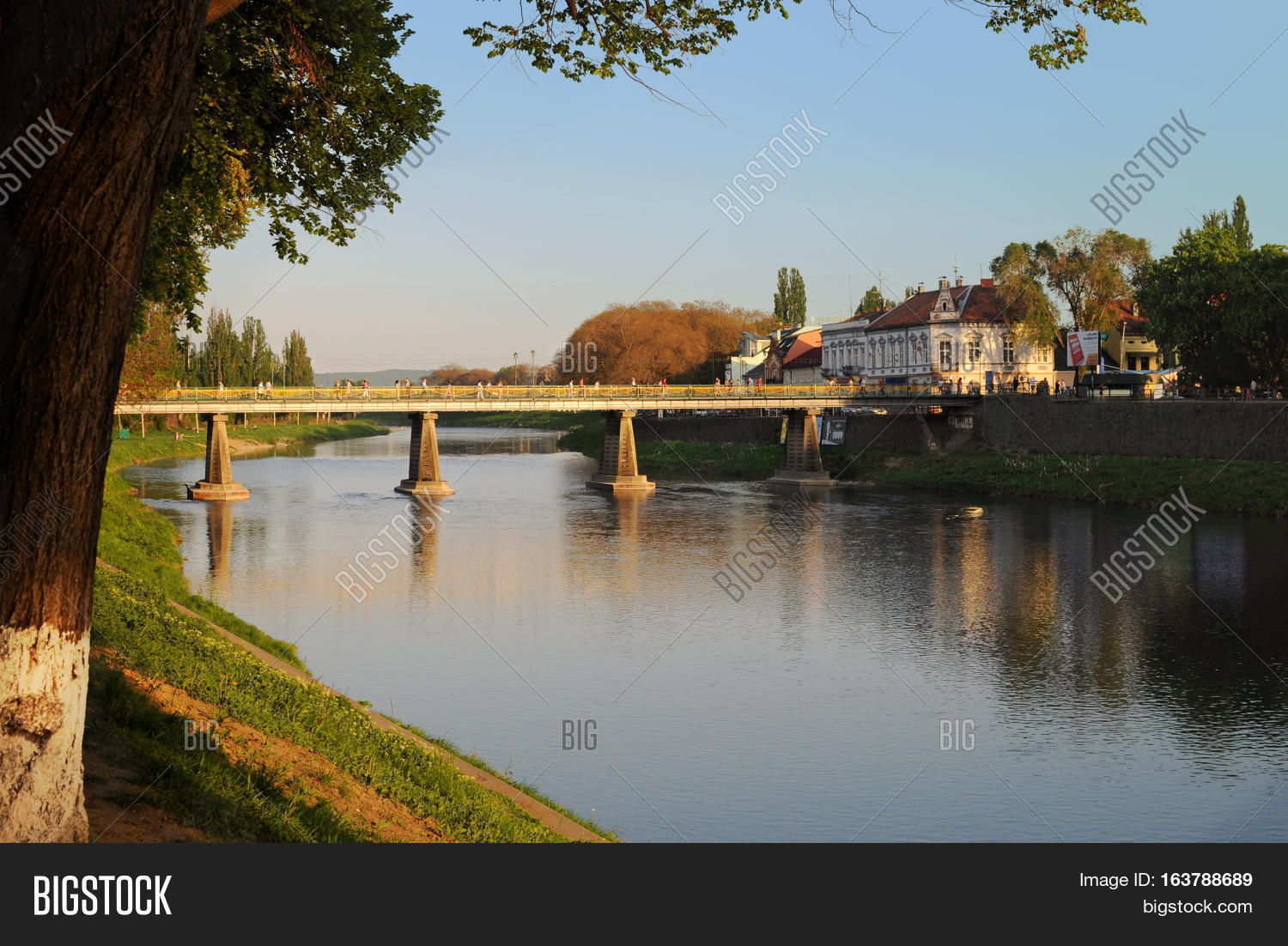 river,ukraine,uzhhorod,uzh,city,sky,landscape,old,blue,town,day,europe,cityscape,ukrainian,nature,beauty,green,people,sunset,travel,outdoor,architecture,tourism,riverside,beautiful,transcarpathia,summer,bridge,lifestyle,grass,water,bank,tree,trunk,branches,buildings,landmark,stone,house,view,warm