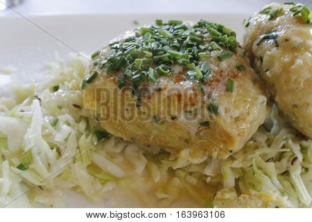 Tyrolean traditional dish, knodel or canederli with parsley stock photo