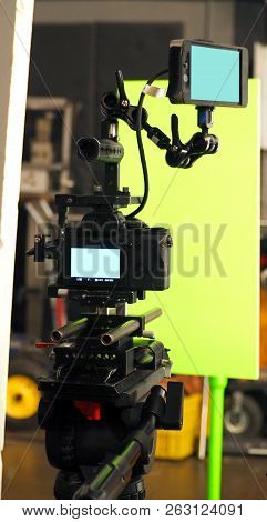 Behind the vdo camera in studio production that shooting or filming green screen background for chroma key technique in post process with professional crew teams and equipments. stock photo
