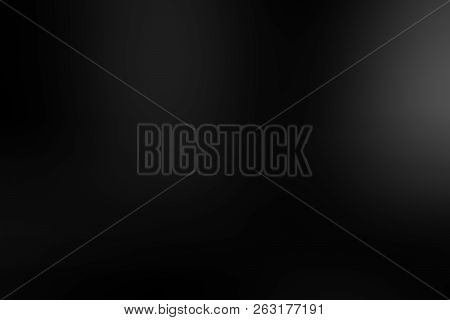 Black gradient with spotlight backdrop wallpaper. Abstract gradient black, used as background for display your products stock photo