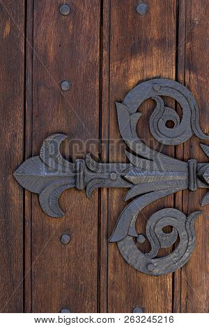 Vintage manacle on massive wooden door close up stock photo